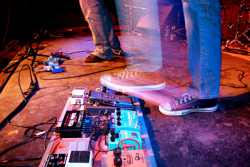 Mid-stride on a Vox Pedal at an Insidious Rays show in Burlington, Vermont.<br /> Photograph by,<br /> Daniel Straine