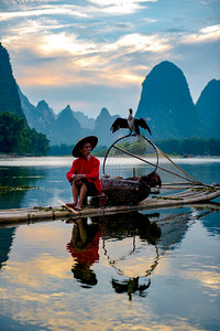 Cormorant fisherman, Li Rver, China. The mountains behind are featured on the Chinese  20 Yuan notes.