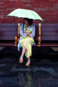 Woman with lime green umbrella, The Forbidden City, China