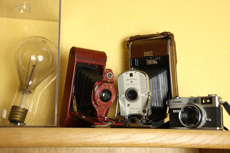 Antique light bulb and cameras