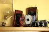 Antique light bulb and cameras