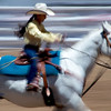 Rodeo Gal with White Hat, Yellow Shirt and White Pony