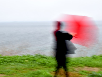 Woman with Red Umbrella in the Wind