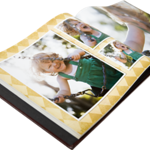 11x8.5 Nuba Photo Books - Open  With the luxurious look of nubuck leather, nuba's paper-based construction feels soft and supple. A charcoal cover with a smooth matte finish is the perfect start to any story, and your two-line custom title is stamped in gold foil.