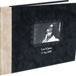 """11x8.5 Two-tone Velvet Photo Books (Premium Covers & Bindings) - Designed by Jodi  Start your story with an elegant, plush cover in black or red with gray contrast. Customize two-lines of title text and choose a picture for the ornately framed, debossed 2.5 x 4"""" cover photo. Cover-weight, archival quality paper is hinge bound so pages lay flat.    Cover:Two-tone Velvet Colors:Black, Red Binding:Hinge Base price:$597 for 20 pages Slip Case (optional):  $200 Add'l pages:$8 per page Max pages:250"""