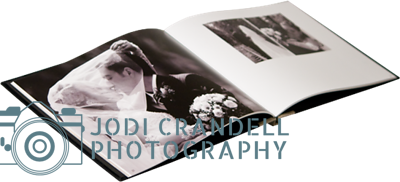 """11x8.5 Two-tone Velvet Photo Books (Premium Covers & Bindings) - Open  Start your story with an elegant, plush cover in black or red with gray contrast. Customize two-lines of title text and choose a picture for the ornately framed, debossed 2.5 x 4"""" cover photo. Cover-weight, archival quality paper is hinge bound so pages lay flat."""