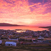 Sunrise over Nólsoy island and Tórshavn.