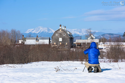 Chris Lawrence lining up a scene of Summit Farm against Mt. Katahdin as a backdrop.