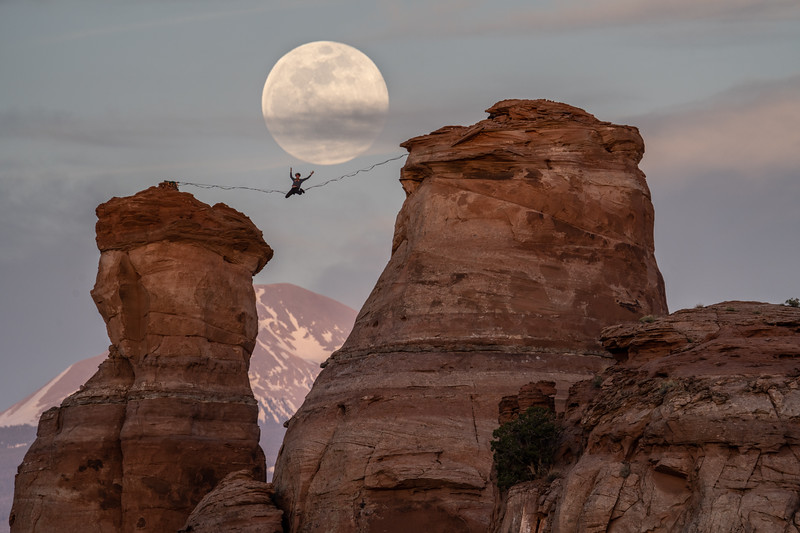 Andy Lewis performing art with the moon
