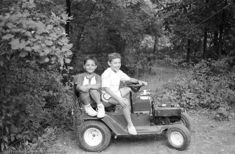 Boys on their lawn tractor