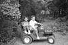 Boys on their lawn tractor