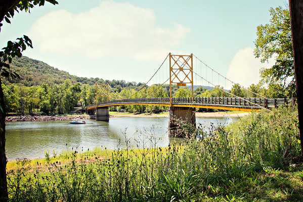 "The ""Little Golden Gate Bridge"" of Arkansas.  Beaver Bridge spans the White River in the town of Beaver on Highway 187 near Eureka Springs.  Built in 1949 the bridge is 554 feet long and 11 feet wide.  Yup, it's only 1 car at a time  Featured in the movie Elizabethtown"