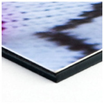 Styrene This super-smooth, compact 2mm styrene board cleanly backs your print, providing durability and protection against dents, bangs and warping. Available in two colors: Black or White.
