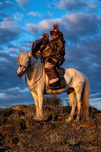 Kazakh-Mongolian Eagle Hunter on Horse at Sunrise
