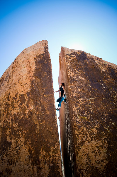Christina Pilo climbs a 30-foot chimney splitting a massive boulder at the Kraft Boulders in Red Rock Canyon National Conservation Area, Nevada