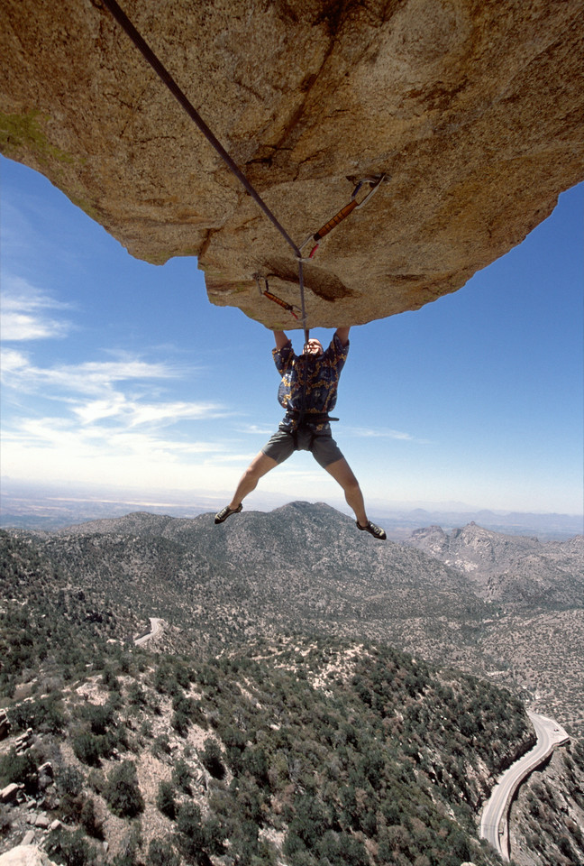 "Gabe E. Metzger climbs his eponymous route, ""G.E.M."" (5.12) High above the Mount Lemmon Highway, Arizona."