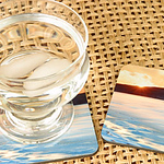 "Photo Coasters Set of four, each 4 inches square with cork back.  Coasters come in sets of 4 (only two are shown in this photo) and measure:  3.75 x 3.75"" They're slightly more than 1/8th inch thick.  Durable, hard and glossy surface with cork back."