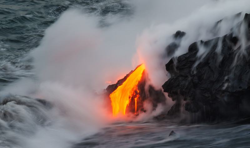 Photo taken at sunset after a 2.5 mile hike to active flowing lava.