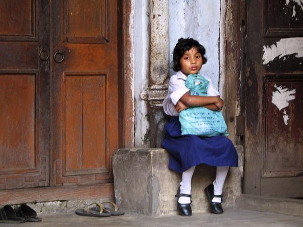 "School girl at 50 Amherst Street, Kolkata, India, one of the homes where Maunda Lal Gosh (Paramahansa Yogananda) lived as a boy and where his mother died. it is also where ""Master Mahasya"" (""M"" or Mahendra Nath Gupta - author of ""gospel of Ramakrishna"" lived)"