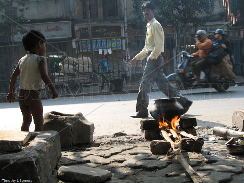 Kolkata street with boy & fire