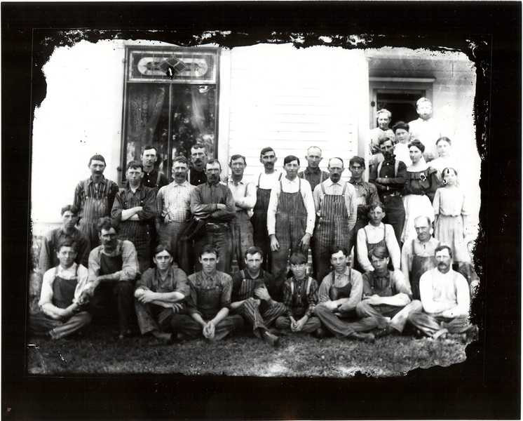 "Farm hands gathered after a meal after a day in the ""threshing ring"" in rural central Illinois. Circa Summer 1908. Photo take at the Cain family home by James T. Somers."