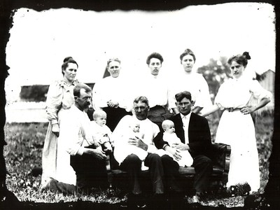 Photographer James T. Somers - front row, far left and wife Hanora behind him.