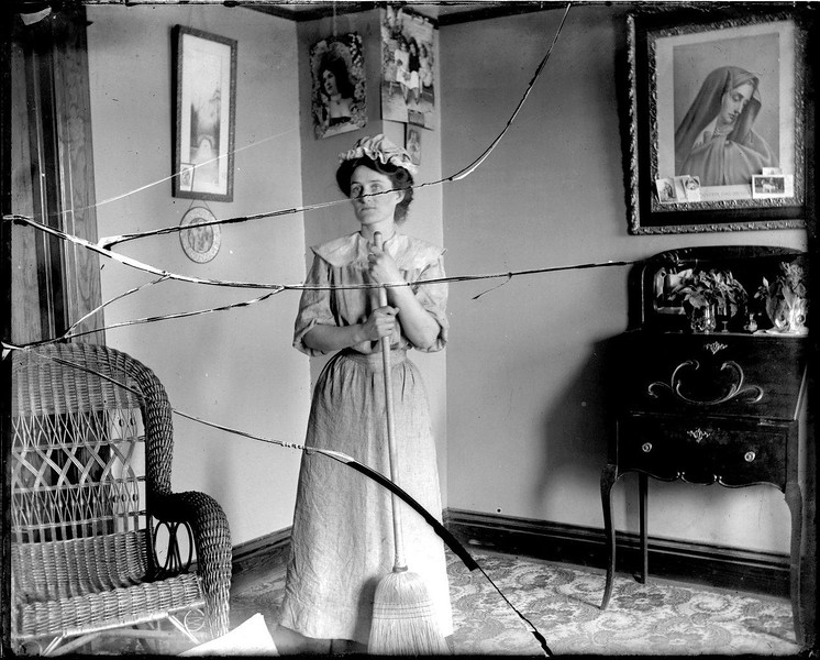 Woman with Broom. Circa 1910. Photo by James T. Somers