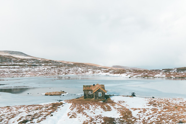 Cabin by the frozen lake.
