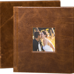 8x8 Genuine Leather (Premium Cover & Binding) - Designed by Jodi  Dress up your best memories with a full-grain leather cover that's hand-distressed for an aged look and feel. Choose black or brown with a custom cover photo and two-line title stamped in foil. Archival-quality, heavyweight pages lay flat in a seamless presentation.    Cover:	Genuine Leather Colors:	Black, Brown Binding:	Board Base price:	$1,047 for 20 pages Slip Case (optional):  $200 Add'l pages:	$8 per page Max pages:	80