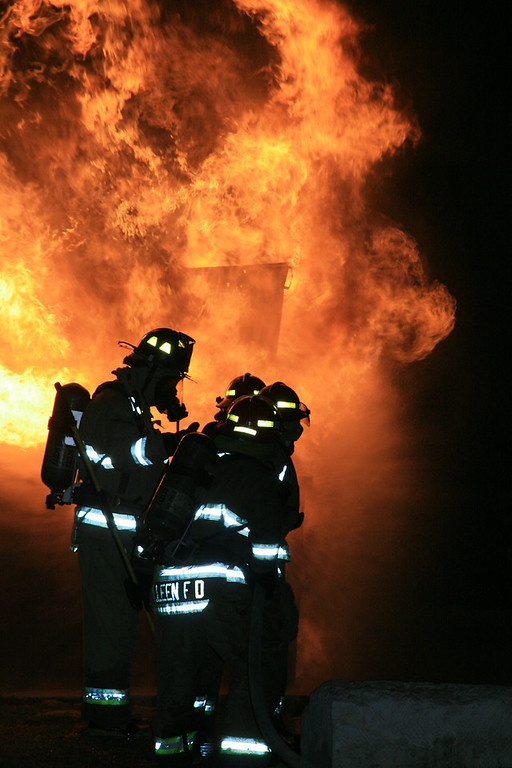 "GLOWING: Young fire fighters train at the practice facility with ""live"" fire."