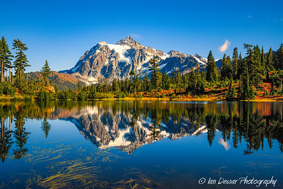 Mount Shuksan reflects during fall in Picture Lake in Washington State