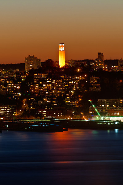 Coit Tower lit in San Francisco Giants orange glow.