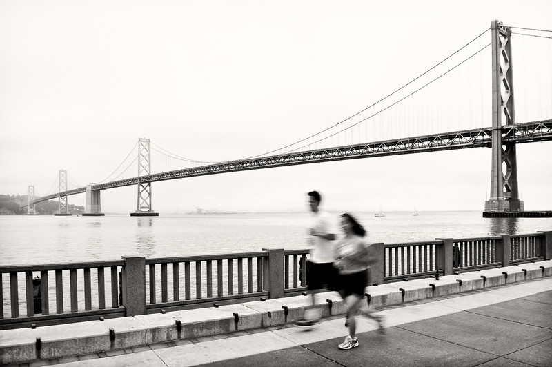 Morning joggers on the Embarcadero in San Francisco.