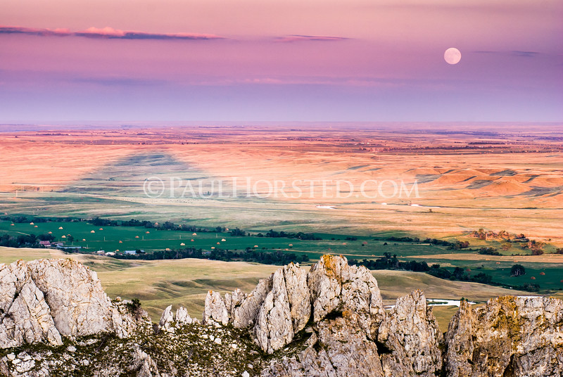 From summit of Bear Butte at sunset, with moon rising in east.