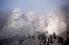 Mt. Rushmore at sunrise in fog.