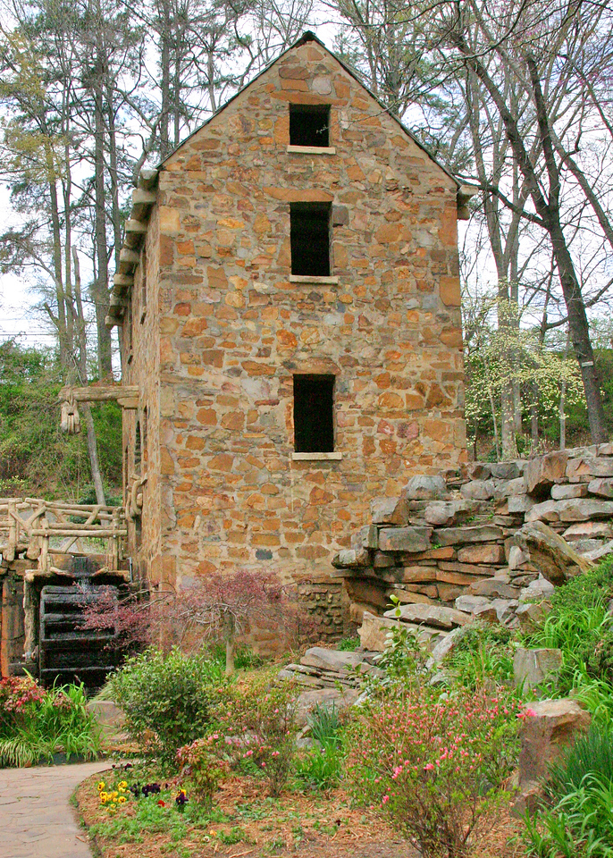 Mill with early spring foliage<br /> The Old Mill