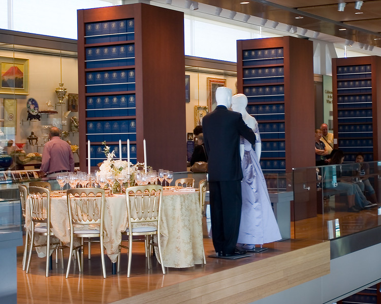 One of the exhibits featuring President Clinton's suit and Mrs Clinton's gown -- as well as the place settings that were used for the occasion.