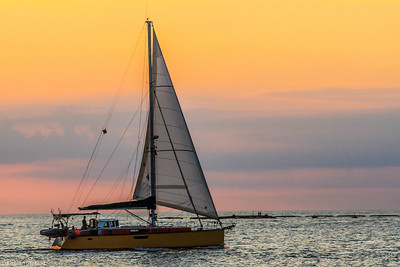 Yellow Sailboat At Sunrise