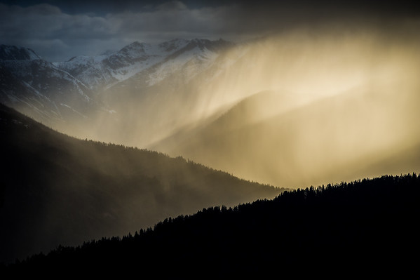 Last moments of sunset peaking through the spring storm, North Cascades National Park