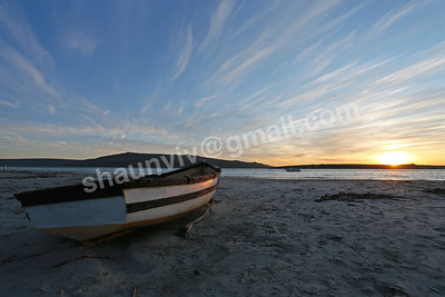 A fishing boat on the beach at sunset in Langebaan, South Africa