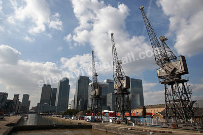 The South Dock cranes with Canary Wharf Business District in the background.