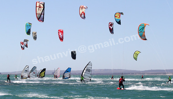 Kiteboarders and Windsufers in action in Langebaan, South Africa