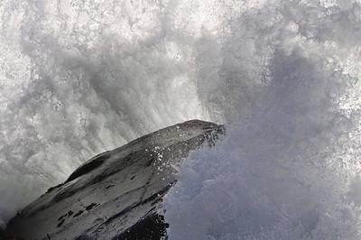 Waves breaking on a rock