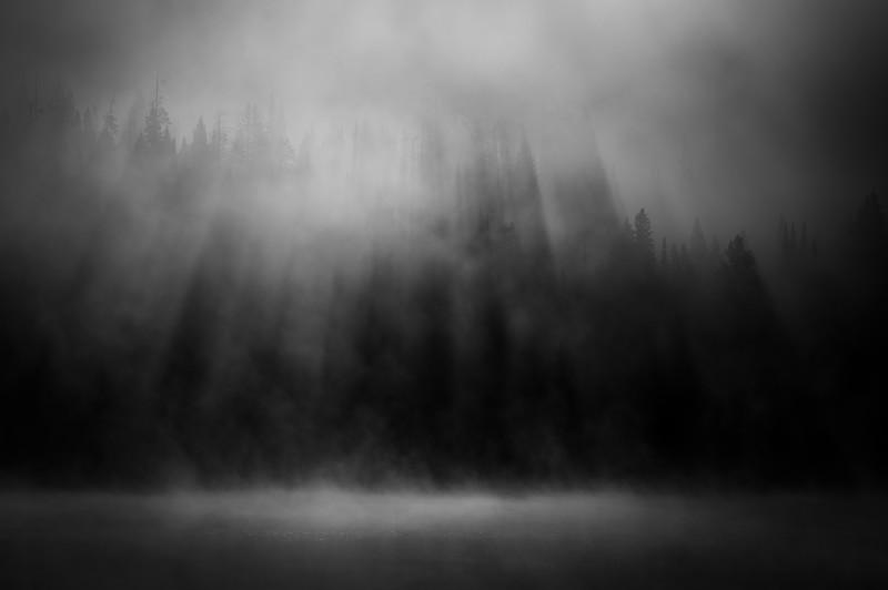 Sunrise streaming over Hyalite Reservoir in the morning mist