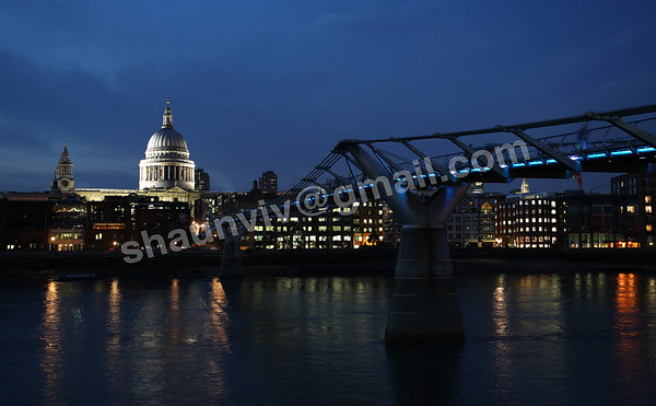 Millennium Footbridge and the illuminated St Paul's Cathedral dome in London, England.