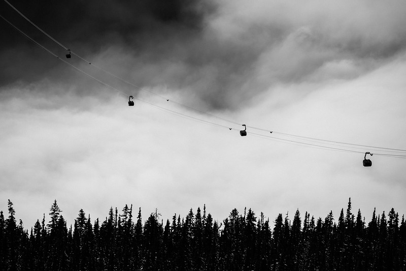 Patiently waiting over the clouded landscape, Whistler BC