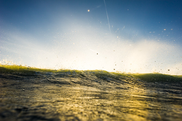 Reverse angle of morning offshore winds on a breaking wave, San Diego California