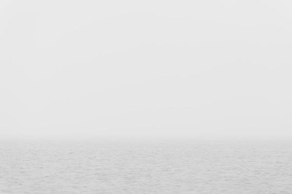 Morning fog blurring the horizon along the Washington coastline