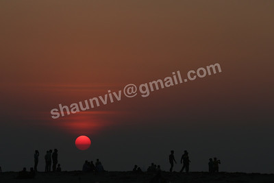 Indians watch the sun set at Kochi Fort in Kochi, India