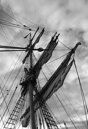 Mast and sails of a brig - monochrome